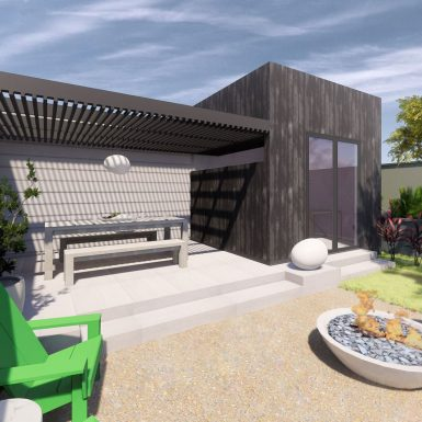 Exterior view of backyard and veranda, with the office addition clad in charred wood (shou sugi ban). A firepit and palo verde tree complement the outdoor living space.