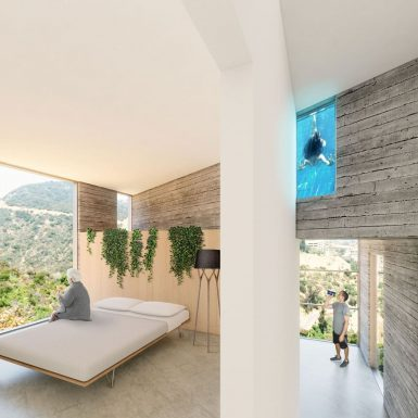 Interior view into contemporary board-formed concrete guest bedroom. A side window allows a view into the cantilevered infinity pool that swoops through the space.