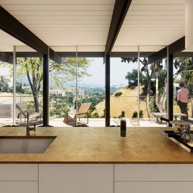 Looking out across the natural brass kitchen countertop at the landscape and skyline beyond, under mid century modern post and beam construction.