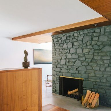 Ranch Redux - Interior view of the stone fireplace and warm wood materials. Photograph by Tomoko Matsubayashi.