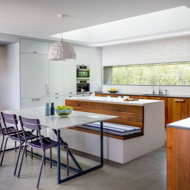 Ranch Redux - Interior view of modern, light-filled kitchen with long countertop window and skylight. Photograph by Trevor Tondro.