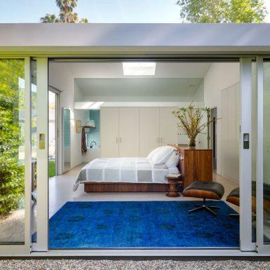 Ranch Redux - Exterior view into modern master bedroom through sliding door. Photograph by Trevor Tondro.