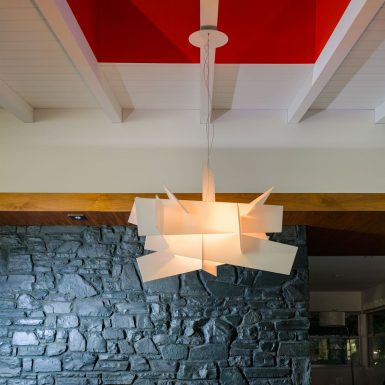 Ranch Redux - Interior view of dining room skylight and modern pendant light fixture. Photograph by Trevor Tondro.